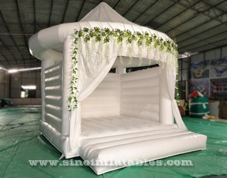 adults wedding all white bouncy castle with Rose decoration
